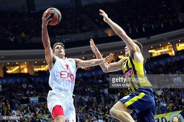 Emporio Armani Milan's Italian guard Bruno Cerella fights for the ball with Fenerbahce Ulker's Croatian forward Bojan Bogdanovic during the Top 16...
