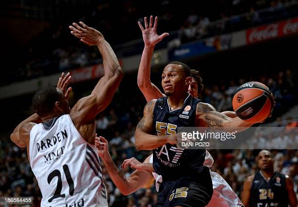 Emporio Armani Milan's US guard Curtis Jerrells vies with Real Madrid's US forward Tremmell Darden during the Euroleague basketball match Real Madrid...