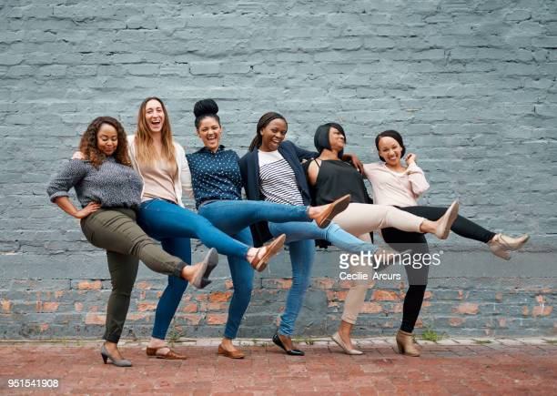 empowered women empower women - kick line stock photos and pictures
