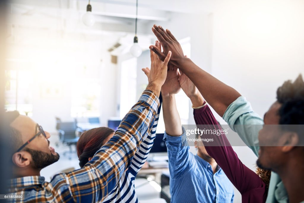 Empowering each other to aim for their best : Stock Photo