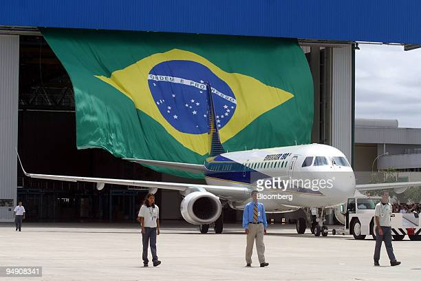 Empresa Brasileira de Aeronautica SA's new Embraer 190 regional jetliner is rolled out at the company's headquarters in Sao Jose dos Campos Brazil on...