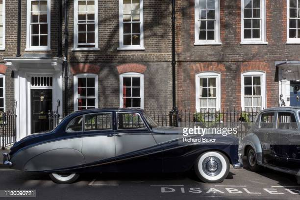 Empress Bentley and a 1954 RollsRoyce Silver Dawn are parked in Smith Square a small square behind the Houses of Parliament before collecting their...