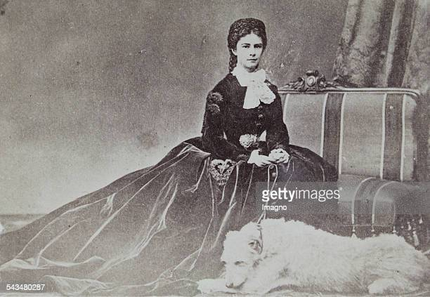 Empress Elisabeth in velvet dress with her dog Houseguard 1865/66 Photograph by Emil Rabending