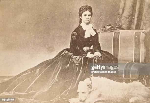 "Empress Elisabeth wearing a velvet dress and her dog ""Houseguard"" 1865/66. Photography. [Kaiserin Elisabeth im Samtkleid mit ihrem Hund Houseguard...."