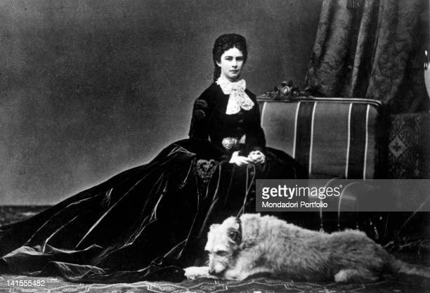 Empress Elizabeth of Bavaria known as Princess Sissi posing next to a dog 1860s