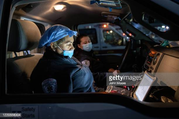 Empress EMS paramedic Patricia Rodriguez fills out reports on a laptop after her shift on April 22 2020 in Yonkers New York Even as the number of...