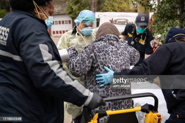 Empress EMS paramedics transport a patient with COVID19 symptoms to a hospital on April 17 2020 in Yonkers New York Yonkers is located in Westchester...