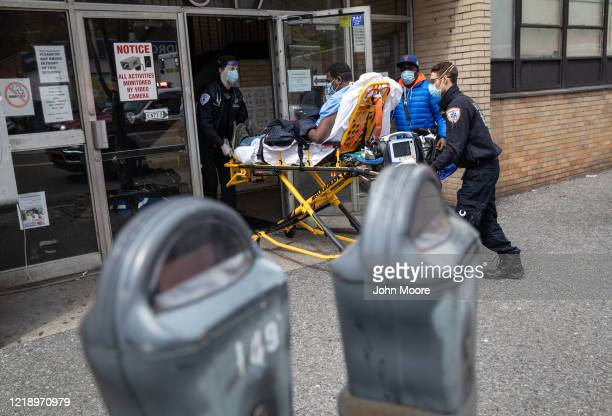 Empress EMTs take a patient with COVID19 symptoms to the hospital on April 14 2020 in Yonkers Westchester County New York Located adjacent to New...