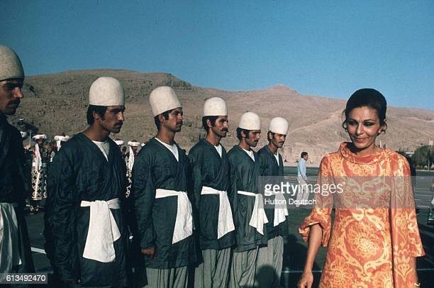 Empress Farah Diba of Iran inspects a row of soldiers in preparation for festivities celebrating the 2500th anniversary of the Persian Empire