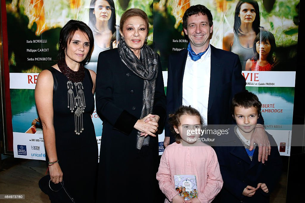 Empress Farah Pahlavi (2nd L), Actress and Director of the movie Ilaria Borrelli (L) her husband Co Director of the movie Guido Freddi, their daughter Alma and their son Furio attend the 'Talking to the Trees - Retour a La Vie' movie screening at Cinema l'Arlequin on March 2, 2015 in Paris, France.