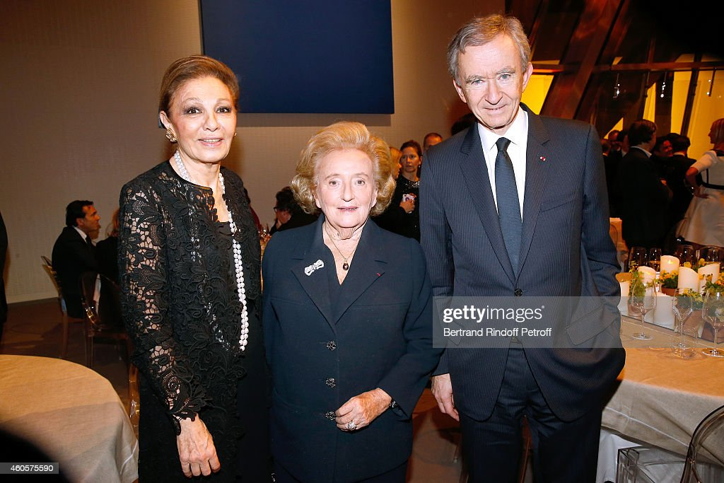 HIH Empress Farah Pahlavi, President of the 'Claude Pompidou Foundation' Bernadette Chirac and Owner of LVMH Luxury Group Bernard Arnault attend the 'Fondation Claude Pompidou' : Charity Party at Fondation Louis Vuitton on December 16, 2014 in Paris, France.