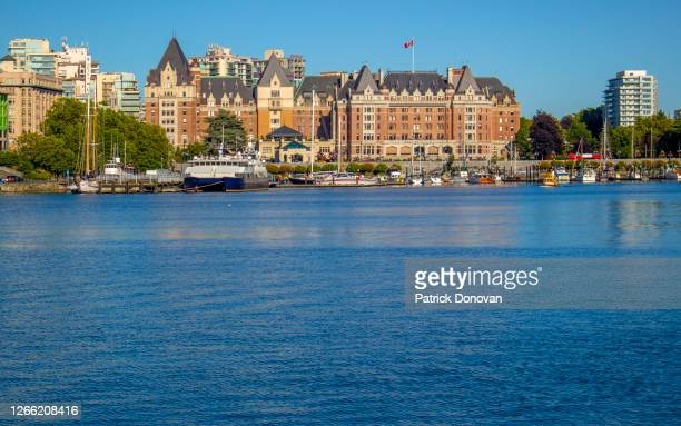 empress hotel and victoria skyline, british columbia, canada - victoria canada stock pictures, royalty-free photos & images