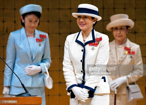 Empress Masako , Crown Princess Kiko of Akishino and Princess Hanako of Hitachi attend the Japan Red Cross Society annual meeting, her first solo...