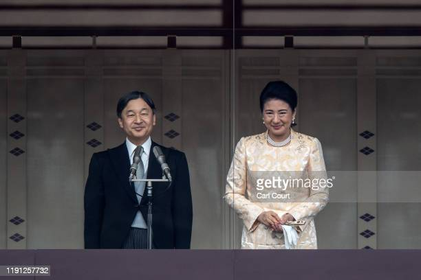 Empress Masako looks on as Emperor Naruhito of Japan delivers a traditional New Year's greeting at the Imperial Palace on January 2, 2020 in Tokyo,...