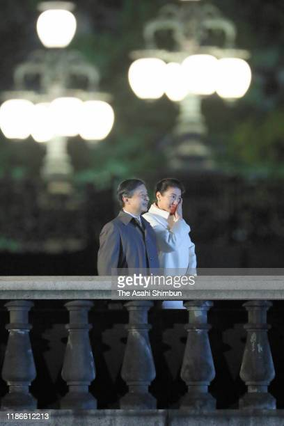 Empress Masako shows her emotion while Emperor Naruhito stands during the National Festival to celebrate the throne of new emperor at the Imperial...