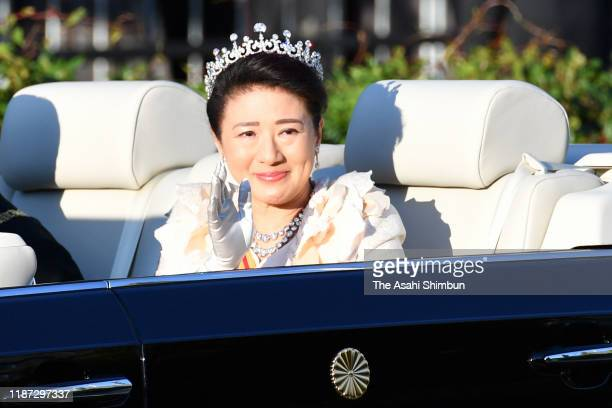 Empress Masako waves from the car during the imperial parade for enthronement of Emperor Naruhito on November 10, 2019 in Tokyo, Japan. Japan's...