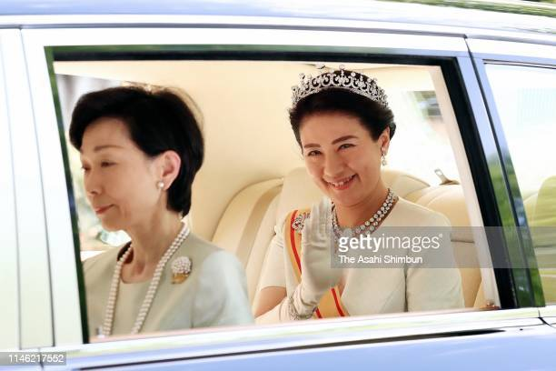 Empress Masako waves to well-wishers on departure for the Imperial Palace prior to the 'Sokui-go-Choken-no-Gi' ceremony that new Emperor Naruhito...