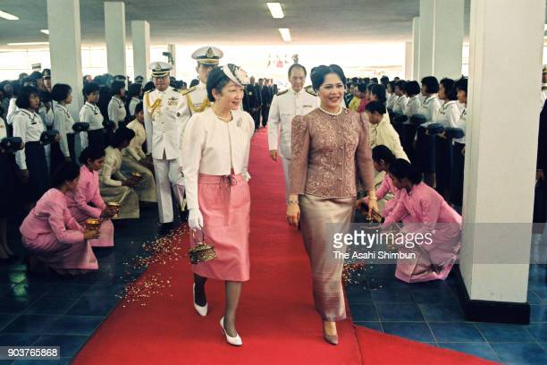 Empress Michiko and Queen Sirikit of Thailand walk after the ceremony on arrival at Bangkok International Airport on September 26, 1991 in Bangkok,...