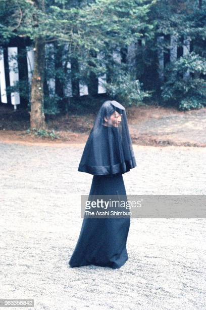 Empress Michiko follows the 'Kiguruma' hearse carrying the body of late Emperor Hirohito during the 'Ryosho no Gi' ceremony at the mausoleum at...