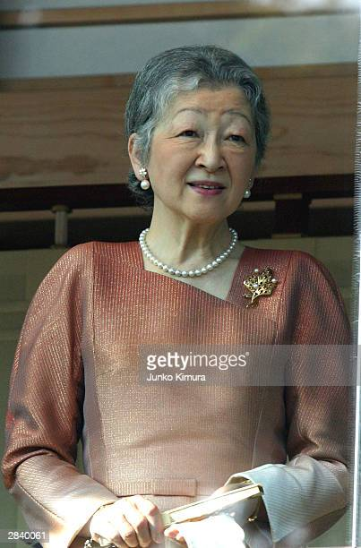 Empress Michiko greets wellwishers during a New Year's appearance at the Imperial Palace January 02 2004 in Tokyo Japan