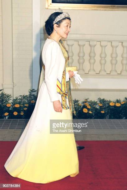 Empress Michiko is escorted by Tuanku Bainun wife of Sultan Azlan Shah of Malaysia prior to the state dinner at the Istana Negara on September 30...