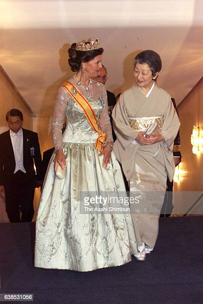 Empress Michiko of Japan and Queen Silvia of Sweden are seen prior to the dinner hosted by Emperor and Empress at a hotel on May 30 2000 in Stockholm...