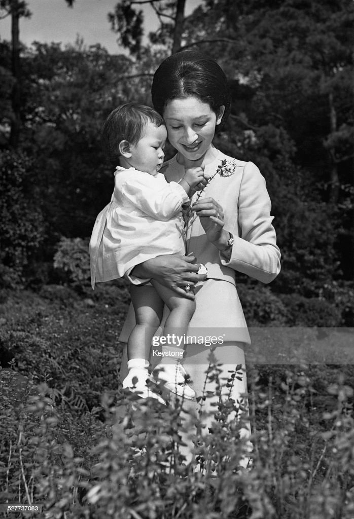 Empress Michiko of Japan with her daughter Sayako, Princess Nori, in the grounds of the palace in Tokyo, Japan, around the time of her 36th birthday, 26th October 1970.