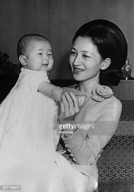 Empress Michiko of Japan with her daughter Sayako, Princess Nori, around the time of her 35th birthday in Tokyo, Japan, October 1969.