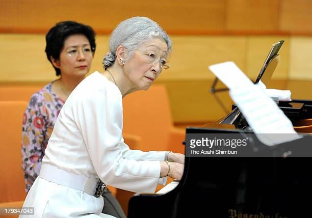 Empress Michiko plays piano during a workshop of the Kusatsu Summer International Music Academy Festival on August 29 2013 in Kusatsu Gunma Japan
