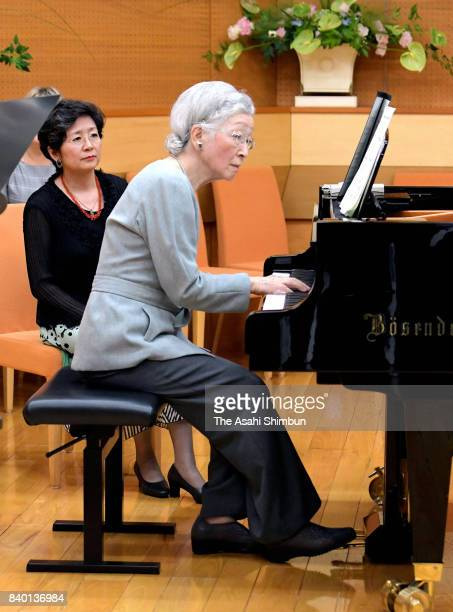 Empress Michiko plays piano during a workshop of the Kusatsu International Summer Music Academy Festival at Kusatsu OngakunoMori International...