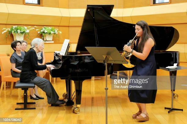 Empress Michiko plays piano with hornist Katerina Javurkova during a session in the 39th Kusatsu Summer International Music Academy and Festival on...