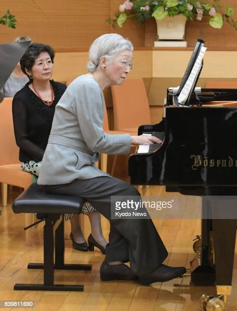 Empress Michiko plays the piano during a music workshop in Kusatsu Gunma Prefecture on Aug 27 2017 The empress and Emperor Akihito have been staying...