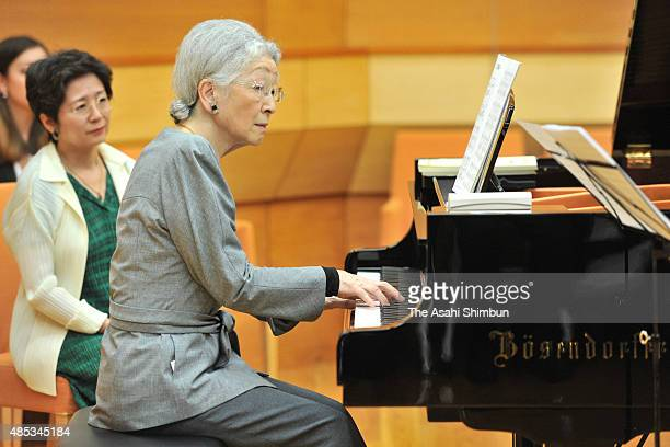Empress Michiko plays the piano during a workshop of the Kusatsu Summer International Music Academy Festival on August 27 2015 in Kusatsu Gunma Japan