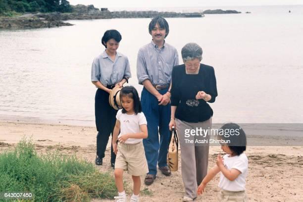 Empress Michiko Prince Akishino Princess Kiko Princess Mako and Princess Kako spend at a beach near the Suzaki Imperial Villa on August 27 1998 in...