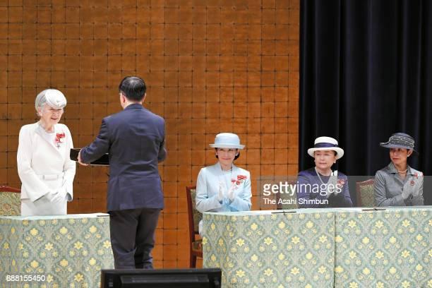 Empress Michiko , Princess Kiko of Akishino , Princess Nobuko of Mikasa and Princess Hisako of Takamado attend the Japanese Red Cross Society annual...