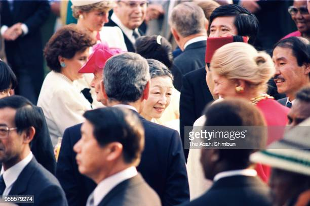 Empress Michiko talks with guests during the garden party celebrating Emperor Akihito's Enthronement at the Akasaka Imperial Garden on November 13...