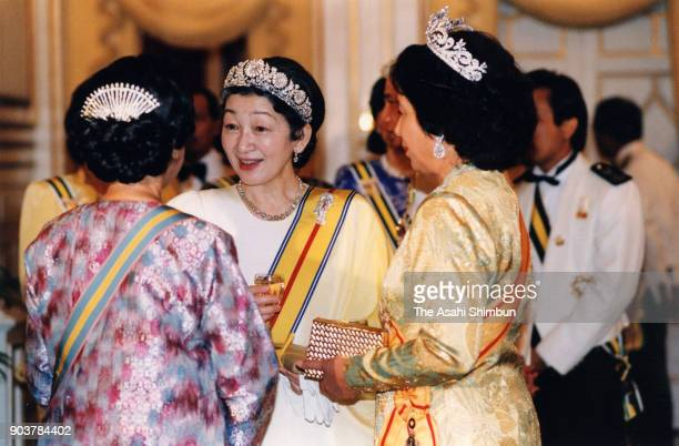 Empress Michiko talks with guests prior to the state dinner at the Istana Negara on September 30 1991 in Kuala Lumpur Malaysia