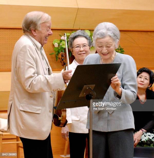 Empress Michiko talks with violinist Werner Hink during a workshop of the Kusatsu International Summer Music Academy Festival at Kusatsu OngakunoMori...