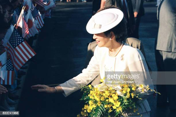 Empress Michiko talks with wellwishers on arrival at the US Air Force Hickam Field on June 23 1994 in Honolulu Hawaii