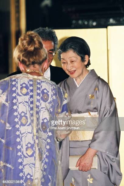Empress Michiko welcomes guests on the receiving line prior to the return dinner hosted by Japanese emperor and empress at Frederiksborg Castle on...