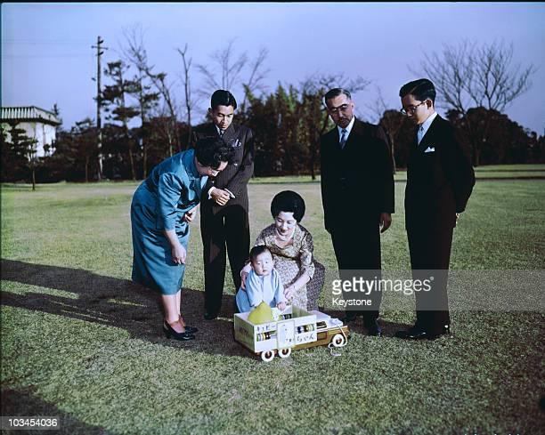 Empress Nagako Crown Prince Akihito baby Prince Hiro Princess Michiko Emperor Hirohito and Prince Hitachi in the gardens of the Imperial Palace in...