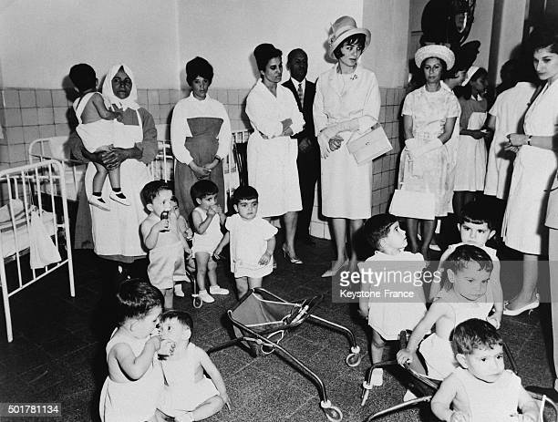 Empress of Iran Farah Diba during her visit in an orphanage where she took time to speak with children and nurses on June 26 1963 in Tehran Iran