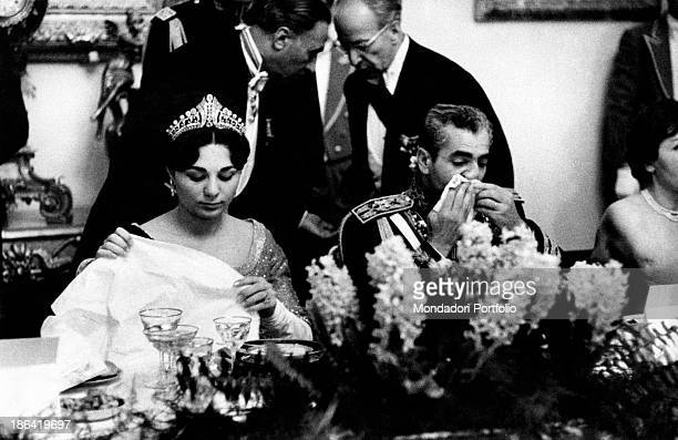 Empress of Iran Farah Pahlavi sitting beside her husband Shah of Iran Mohammad Reza Pahlavi on the occasion of the gala at Golestan Palace in honour...