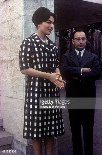 Empress of Iran Farah Pahlavi with a man in the garden of Echtesassi Palace Farah Pahlavi is the third wife of the Shah of Iran Mohammad Reza Pahlavi...