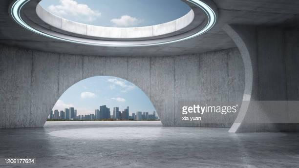 empty abstract concrete space with city skyline - arco architettura foto e immagini stock