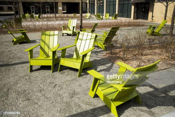 Empty Adirondack chairs sit on the Massachusetts Institute of Technology campus in Cambridge Massachusetts US on Monday April 20 2020...