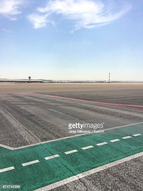 empty airfield against sky - airfield stock pictures, royalty-free photos & images