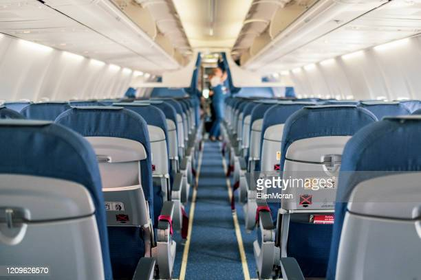 empty airplane cabin interior - airplane stock pictures, royalty-free photos & images