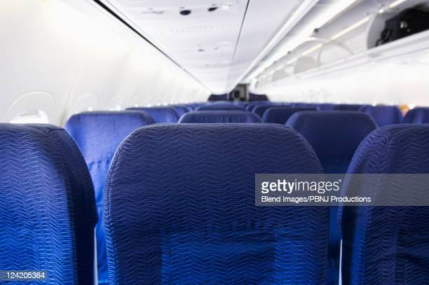 empty airplane cabin - vehicle interior stock pictures, royalty-free photos & images