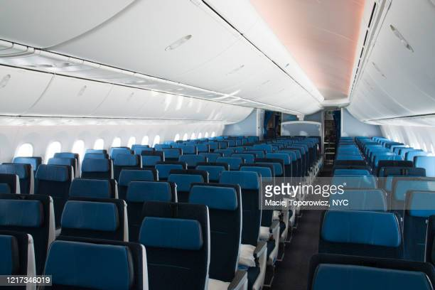 empty airplane seats on a flight from amsterdam to nyc - travel stock pictures, royalty-free photos & images